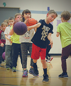 Basketball kids in line to practice their basketball drills.