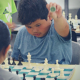YEL chess student prepares to capture the piece from his opponent.