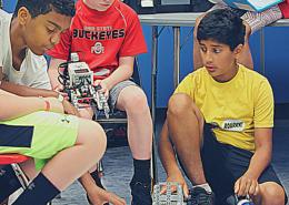 Robotics teams prepare for the Robotics Evolution Challenge.