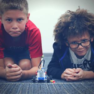 Boys with LEGO car