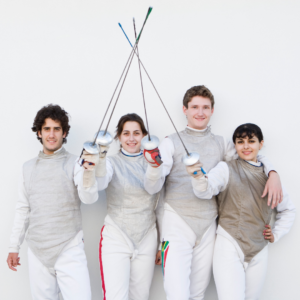 Four fencers posing with their fencing weapons.