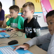 Coding instructor leads students on how to write computer code.