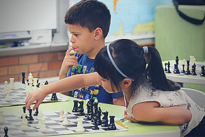 Chess player about to make a great move.